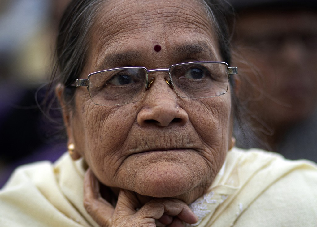 In this Monday, Dec. 23, 2019, photo, Runu Goswami, 77, participates in a protest against the Citizenship Amendment Act in Gauhati, India. Tens of tho...