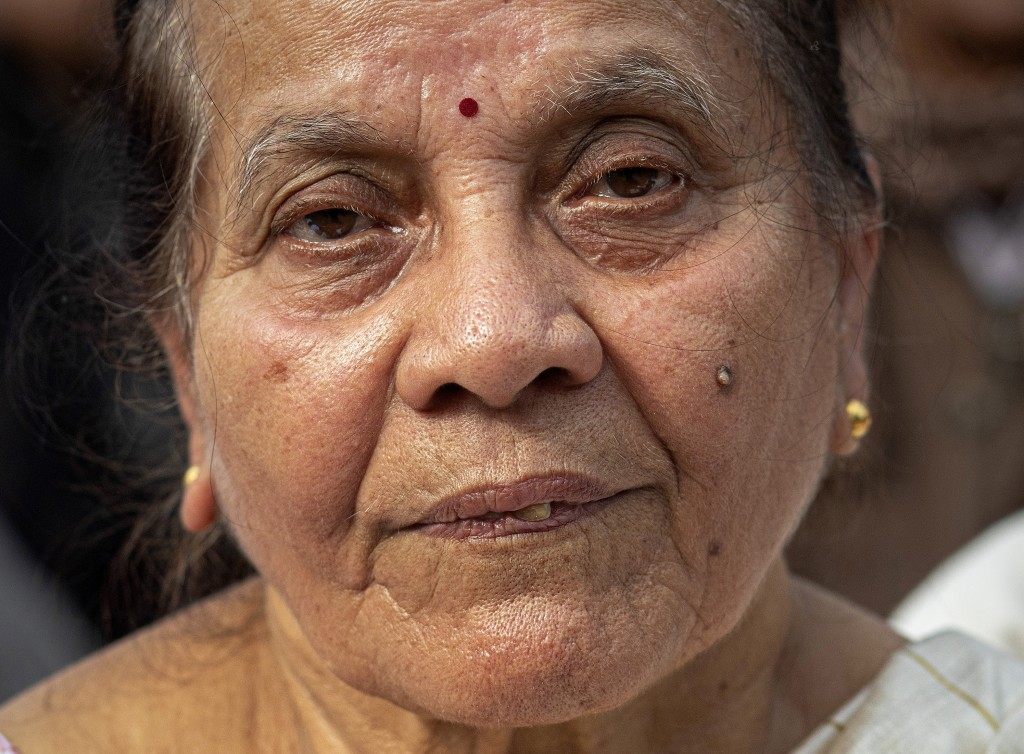 In this Monday, Dec. 23, 2019, photo, Bina Bora, 70, participates in a protest against the Citizenship Amendment Act in Gauhati, India. Tens of thousa...