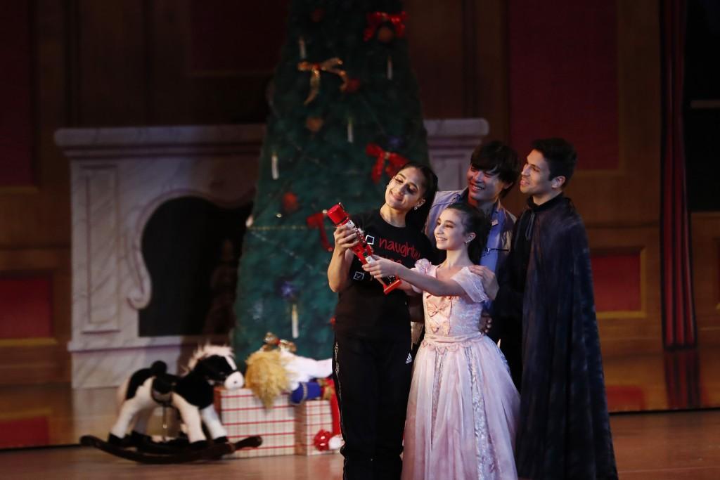 Dancer Lusian Hernandez, left, who portrays Mrs. Stahlbaum, Haowei Zhu, as Mr. Stahlbaum, left back, Sophia Torrens, as Clara, center, and Pablo Manzo...