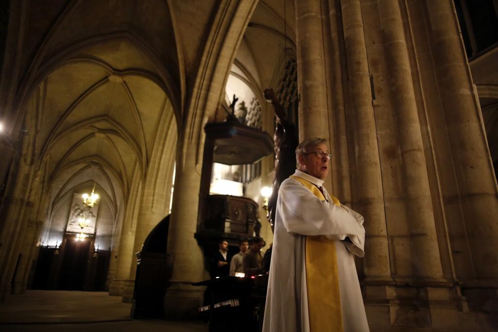 Notre Dame cathedral rector Patrick Chauvet attends the christmas mass, in Saint-Germain l'Auxerrois church, in Paris, Tuesday, Dec. 24, 2019. Notre D...