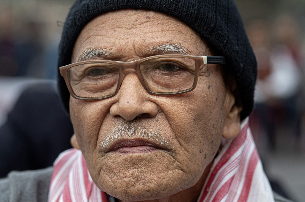 In this Monday, Dec. 23, 2019, photo, Bipin Phukan, 82, participates in a protest against the Citizenship Amendment Act (CAA) in Gauhati, India. Tens ...