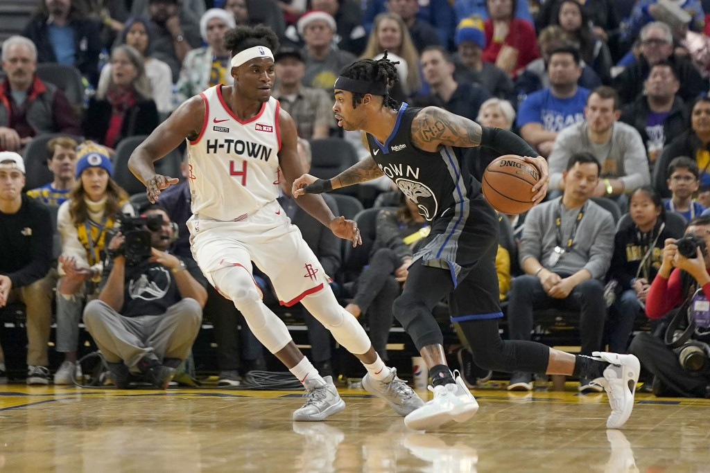 Golden State Warriors guard D'Angelo Russell (0) dribbles past Houston Rockets forward Danuel House Jr. (4) during the first half of an NBA basketball...