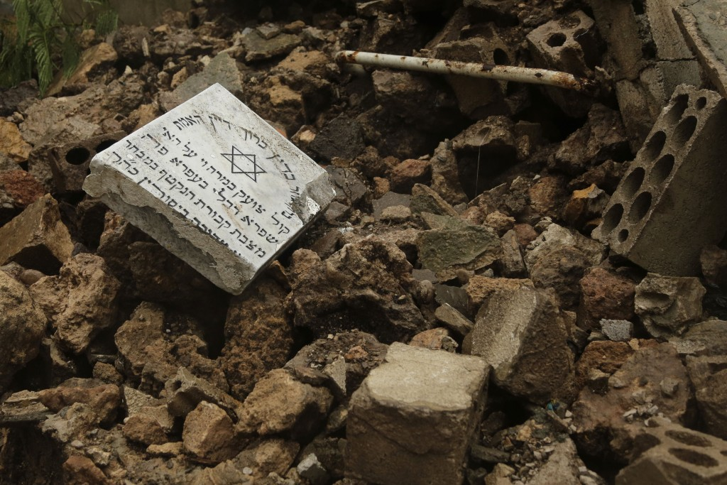 Graves in a Jewish cemetery lie damaged from heavy rains in the Sodeco area of Beirut, Lebanon, Thursday, Dec. 26, 2019. A heavy storm hit Lebanon wit...