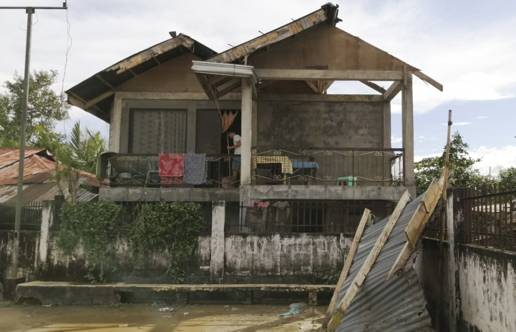 A resident checks his home damaged by Typhoon Phanfone in Ormoc city, central Philippines on Thursday Dec. 26, 2019. The typhoon left over a dozen dea...