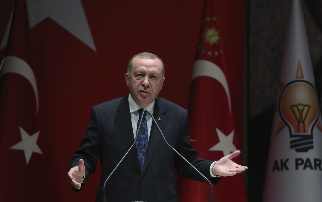 Turkey's President Recep Tayyip Erdogan addresses the members of his ruling party, in Ankara, Turkey, Thursday, Dec. 26, 2019. Erdogan says Thursday h...