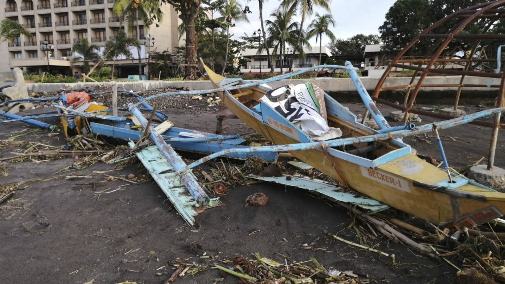 An outrigger boat destroyed by Tphioon Phanfone sits on the coastline Thursday Dec. 26, 2019, in Ormoc City, central Philippines. The typhoon left ove...