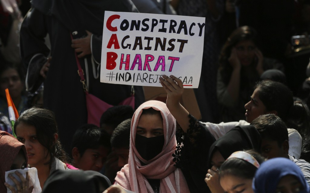 An Indian woman holds a placard during a protest against a new citizenship law that opponents say threatens India's secular identity in Bangalore, Ind...