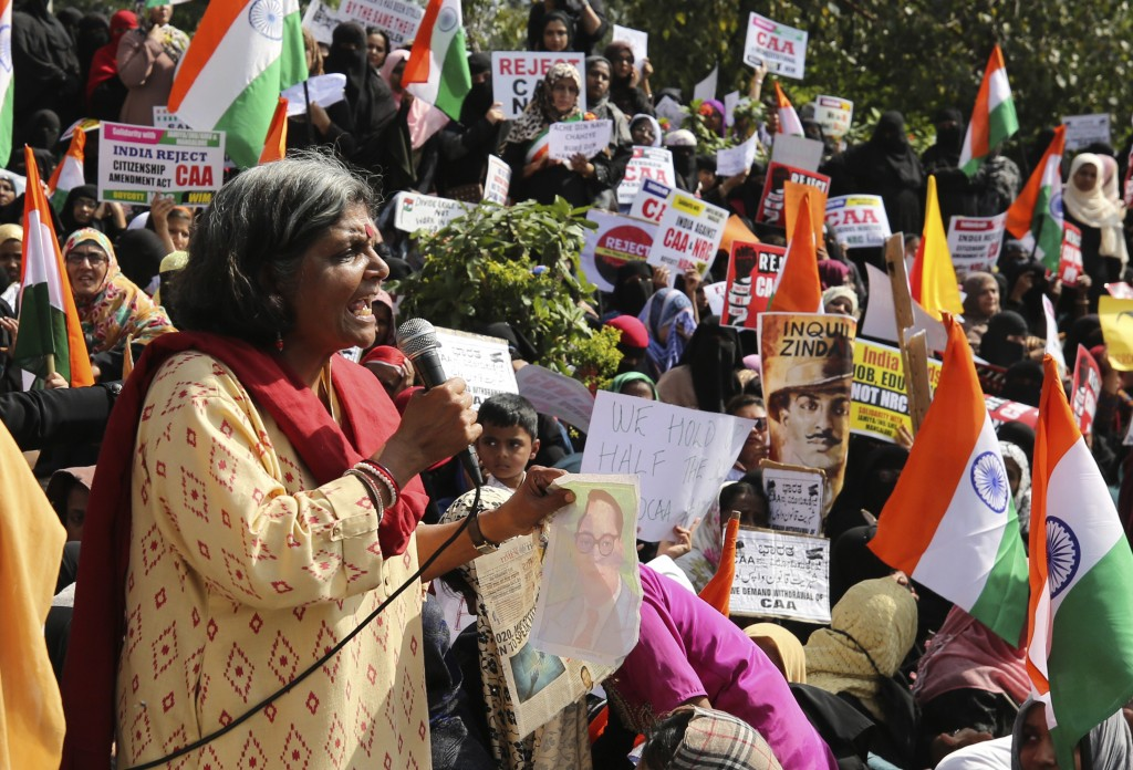An Indian woman speaks during a protest against a new citizenship law that opponents say threatens India's secular identity in Bangalore, India, Thurs...