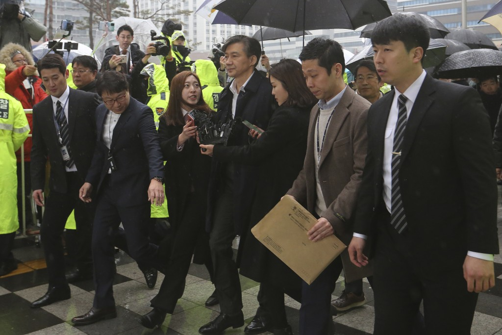 Former Justice Minister Cho Kuk, center, arrives at the Seoul Eastern District Court in Seoul, South Korea, Thursday, Dec. 26, 2019. Cho on Thursday a...