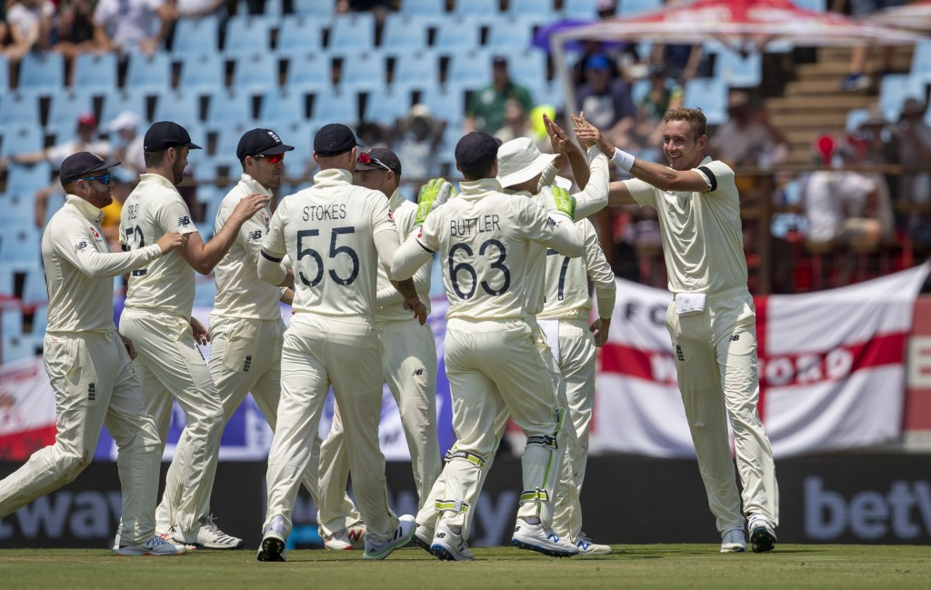 England's bowler Stuart Broad, far right, celebrates with teammate after dismissing South Africa's captain Faf du Plessis for 29 runs on day one of th...
