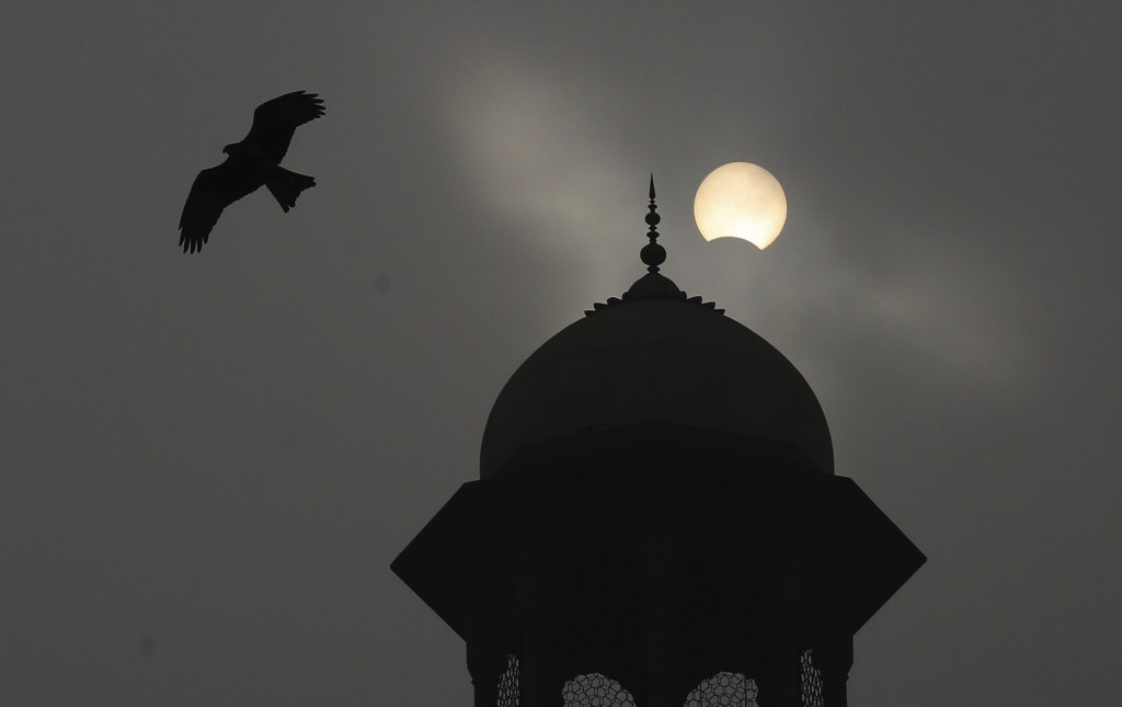 A partial solar eclipse is seen from Lahore, Pakistan, Thursday, Dec. 26, 2019. The last solar eclipse of 2019 was witnessed in Pakistan along with se...