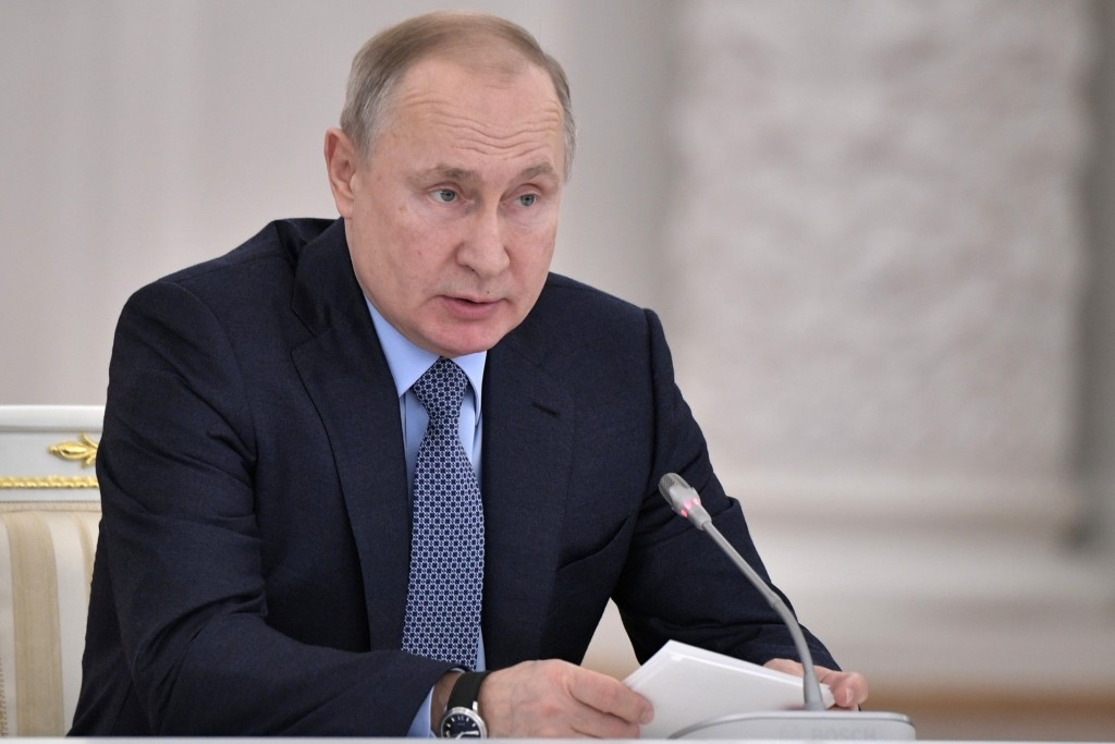 Russian President Vladimir Putin attends the State Council meeting on the agricultural policy at the Kremlin in Moscow, Russia, Thursday, Dec. 26, 201...