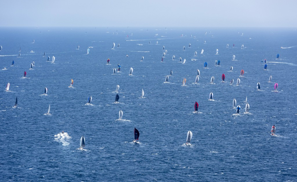 Competitors begin their journey south after the start of the 75th Sydney Hobart yacht race in Sydney Harbour, Thursday, Dec. 26, 2019. (Rolex/Kurt Arr...