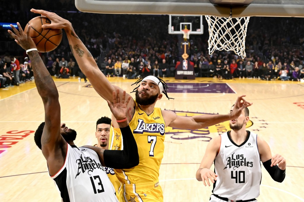 Los Angeles Lakers' JaVale McGee (7) blocks a shot by Los Angeles Clippers' Paul George (13) during the first half of an NBA basketball game Wednesday...