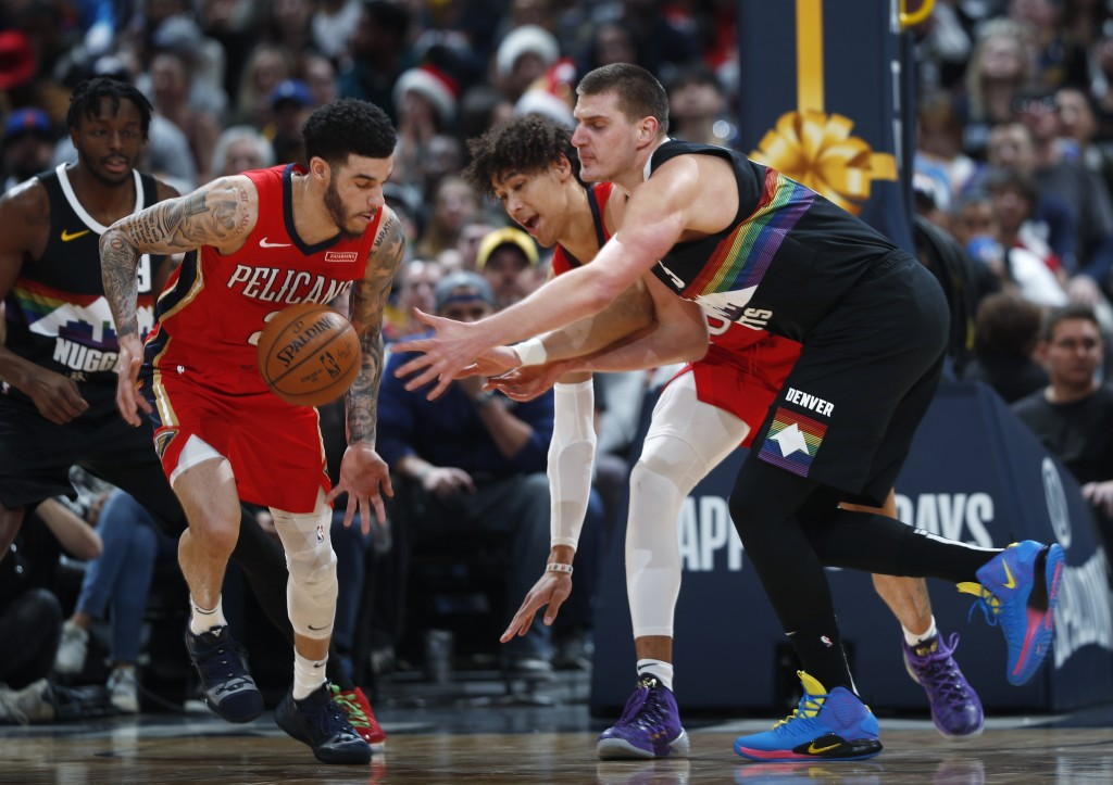 From left, New Orleans Pelicans guard Lonzo Ball, front left, and center Jaxson Hayes and Denver Nuggets center Nikola Jokic pursue the ball during th...