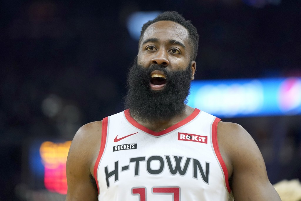 Houston Rockets guard James Harden questions a referee's call during the first half of the team's NBA basketball against the Golden State Warriors in ...