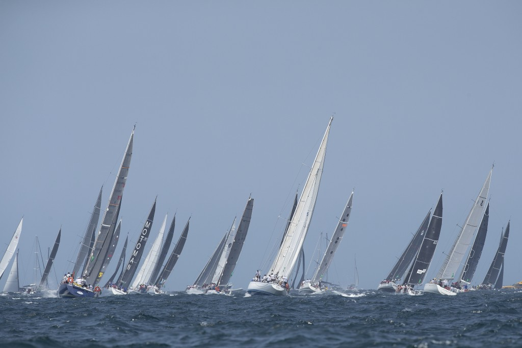 The fleet head into open water towards Hobart during the start of the Sydney Hobart yacht race on Sydney Harbour, Thursday, Dec. 26, 2019. (AP Photo/S...