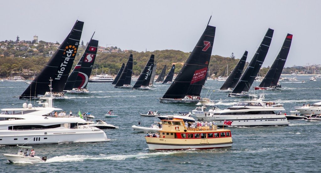 Competitors, back, race past spectators at the start of the 75th Sydney Hobart yacht race in Sydney Harbour, Thursday, Dec. 26, 2019. (Rolex/Carlo Bor...