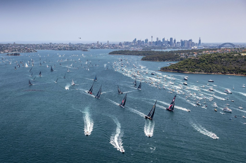 Competitors and the spectator fleet, right, race along at start of the 75th Sydney Hobart yacht race in Sydney Harbour, Thursday, Dec. 26, 2019. (Role...