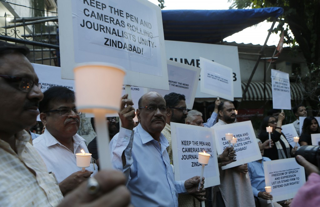 Journalists participate in a protest against attacks on fraternity members while covering protests against the Citizenship Amendment Act in Mumbai, In...