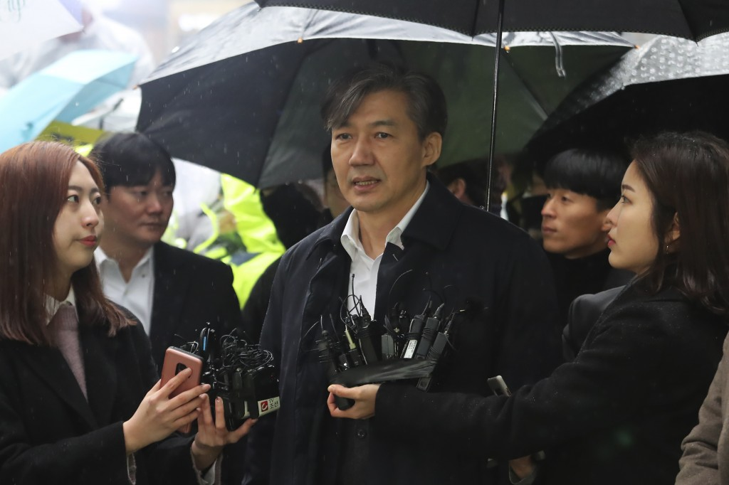 Former Justice Minister Cho Kuk, center, speaks upon his arrival at the Seoul Eastern District Court in Seoul, South Korea, Thursday, Dec. 26, 2019. C...