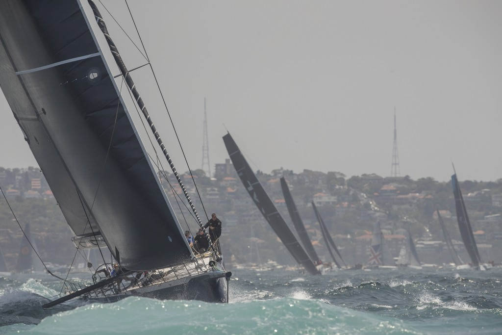 Black Jack heads to the outside marker during the start of the Sydney Hobart yacht race on Sydney Harbour, Thursday, Dec. 26, 2019. (AP Photo/Steve Ch...
