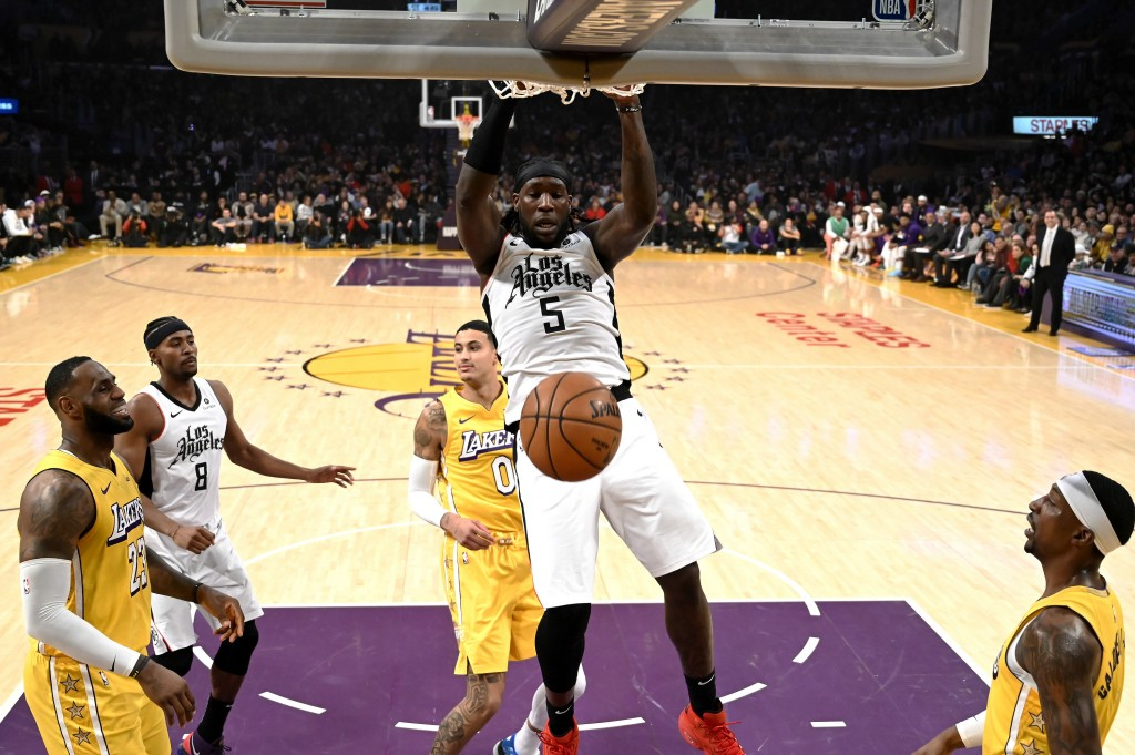 Los Angeles Clippers' Montrezl Harrell (5) dunks against Los Angeles Lakers during the first half of an NBA basketball game Wednesday, Dec. 25, 2019, ...