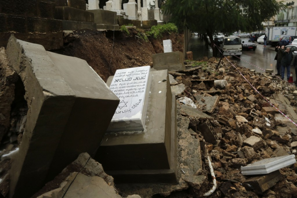 Graves in a Jewish cemetery sit damaged from heavy rains in the Sodeco area of Beirut, Lebanon, Thursday, Dec. 26, 2019. A heavy storm hit Lebanon wit...