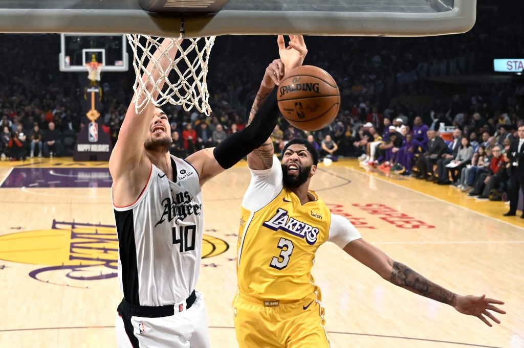 Los Angeles Clippers' Ivica Zubac (40) is fouled by Los Angeles Lakers' Anthony Davis (3) during the first half of an NBA basketball game Wednesday, D...