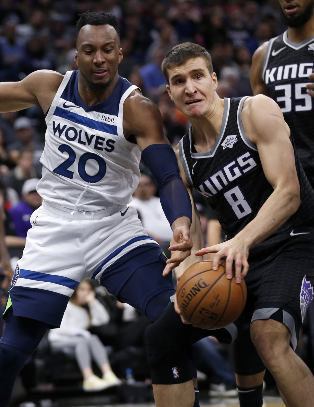 Sacramento Kings guard Bogdan Bogdanovic, right, grabs a rebound against Minnesota Timberwolves guard Josh Okogie during the first quarter of an NBA b...