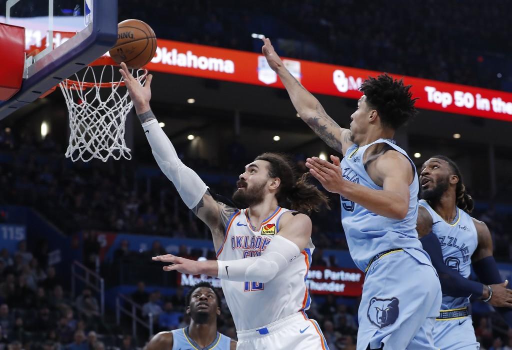 Oklahoma City Thunder center Steven Adams (12) goes up for a basket ahead of Memphis Grizzlies forward Brandon Clarke (15) during the second quarter o...