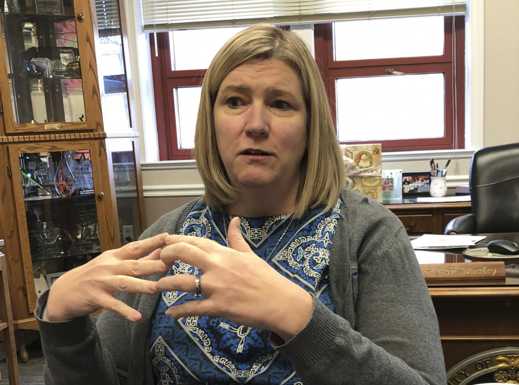 Dayton mayor Nan Whaley is interviewed in her office on Thursday, Dec. 19, 2019 in Dayton, Ohio.  With a period of around 10 weeks, Dayton dealt with ...