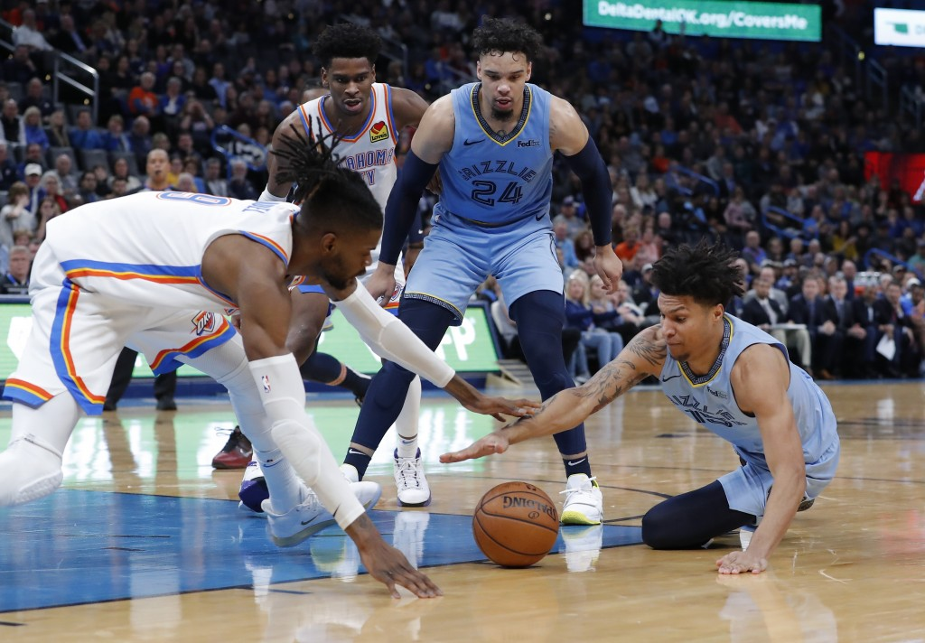 Oklahoma City Thunder center Nerlens Noel (9) and Memphis Grizzlies forward Brandon Clarke (15) battle for the ball during the second half of an NBA b...