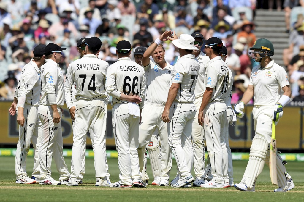 New Zealand players celebrate the wicket of Australia's Tim Paine, right, during play in their cricket test match in Melbourne, Australia, Friday, Dec...