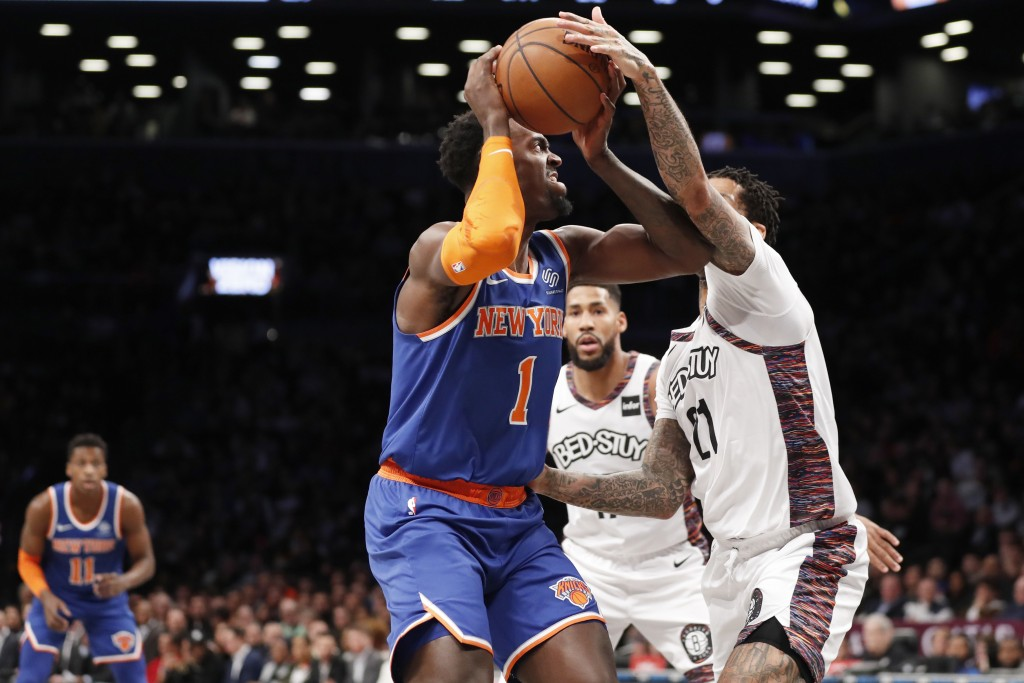 Brooklyn Nets forward Wilson Chandler (21) fouls New York Knicks forward Bobby Portis (1) during the first half of an NBA basketball game, Thursday, D...