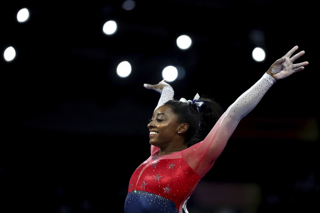File-This Oct. 8, 2019, file photo shows Simone Biles of the U.S. performs on the vault during the women's team final at the Gymnastics World Champion...
