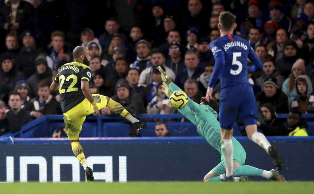 Southampton's Nathan Redmond, left, scores his side's second goal of the game during their English Premier League soccer match against Chelsea at Stam...
