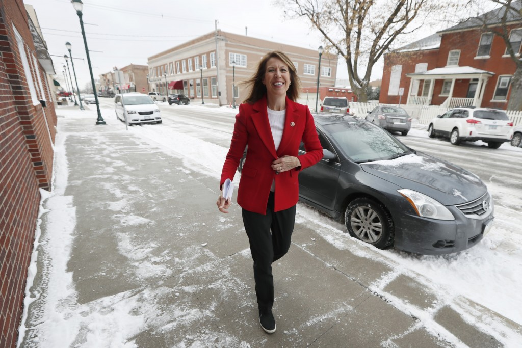 In this Nov. 11, 2019, photo, U.S. Rep. Cindy Axne, D-Iowa, arrives at the American Legion Post 184 to speak to local residents in Winterset, Iowa. Ax...