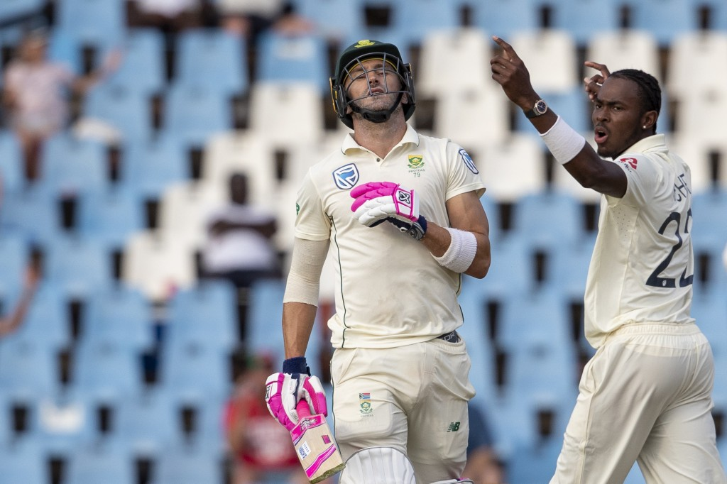 South Africa's captain Faf du Plessis, left, reacts after being dismissed by England's bowler Jofra Archer for 20 runs on day two of the first cricket...