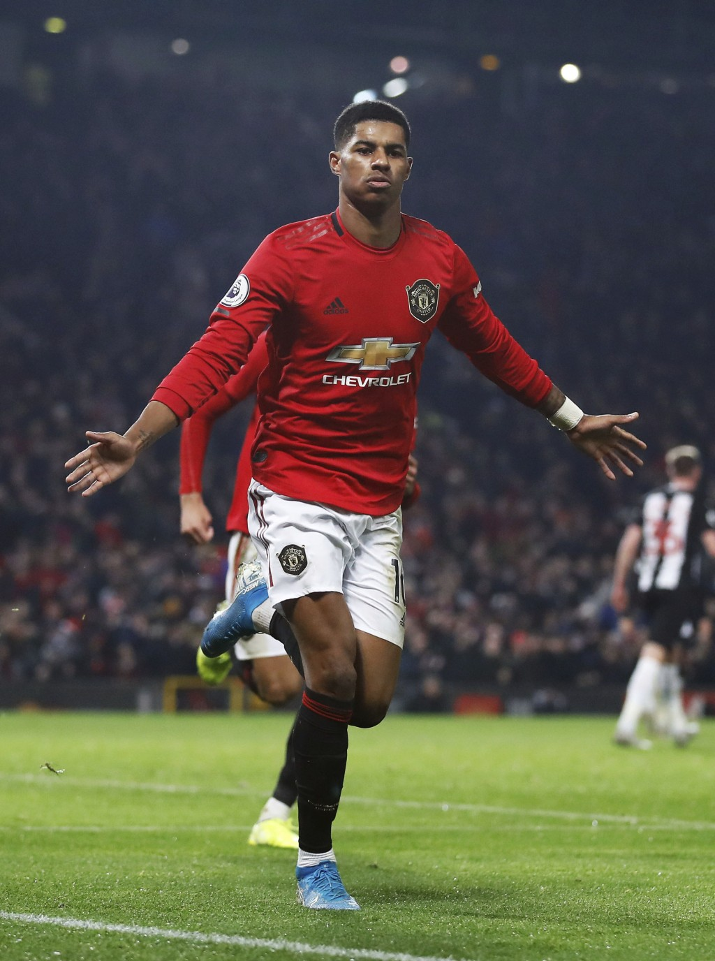 Manchester United's Marcus Rashford celebrates scoring his side's third goal of the game during their English Premier League soccer match against Newc...