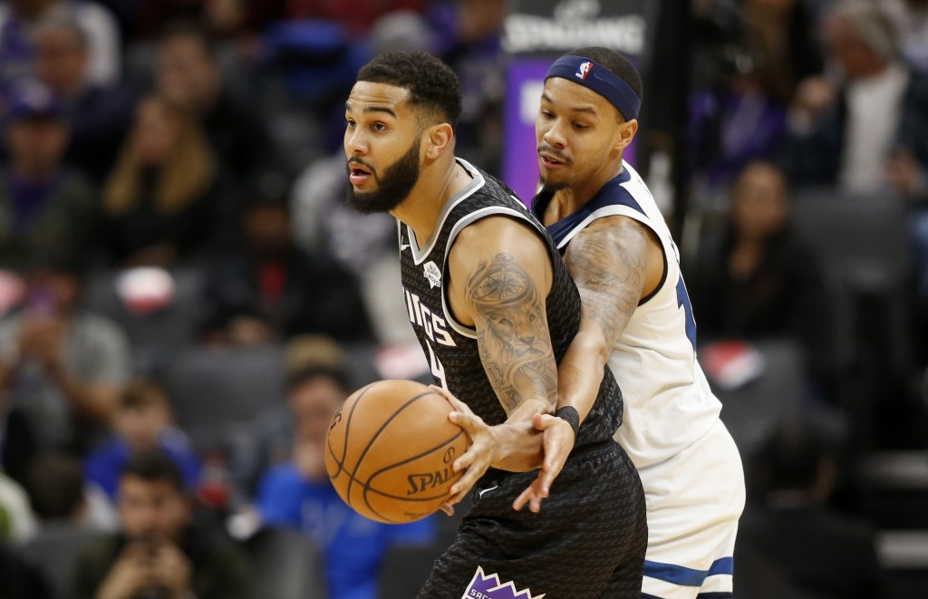 Minnesota Timberwolves guard Shabazz Napier, right, tries to steal the ball from Sacramento Kings guard Cory Joseph during the first quarter of an NBA...