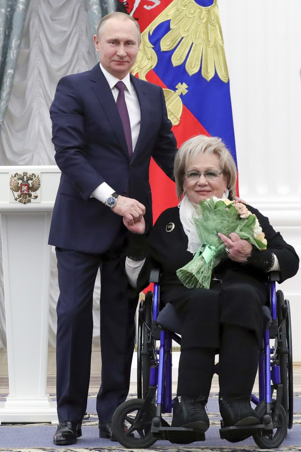 FILE - In this Friday, April 28, 2017 file photo, Russian President Vladimir Putin presents a medal to art director of the Sovremennik theater Galina ...
