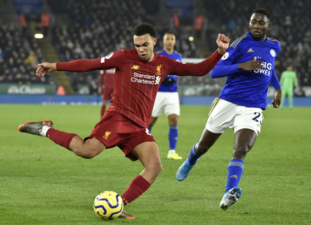 Liverpool's Trent Alexander-Arnold, left, kicks the ball ahead of Leicester's Wilfred Ndidi during the English Premier League soccer match between Lei...