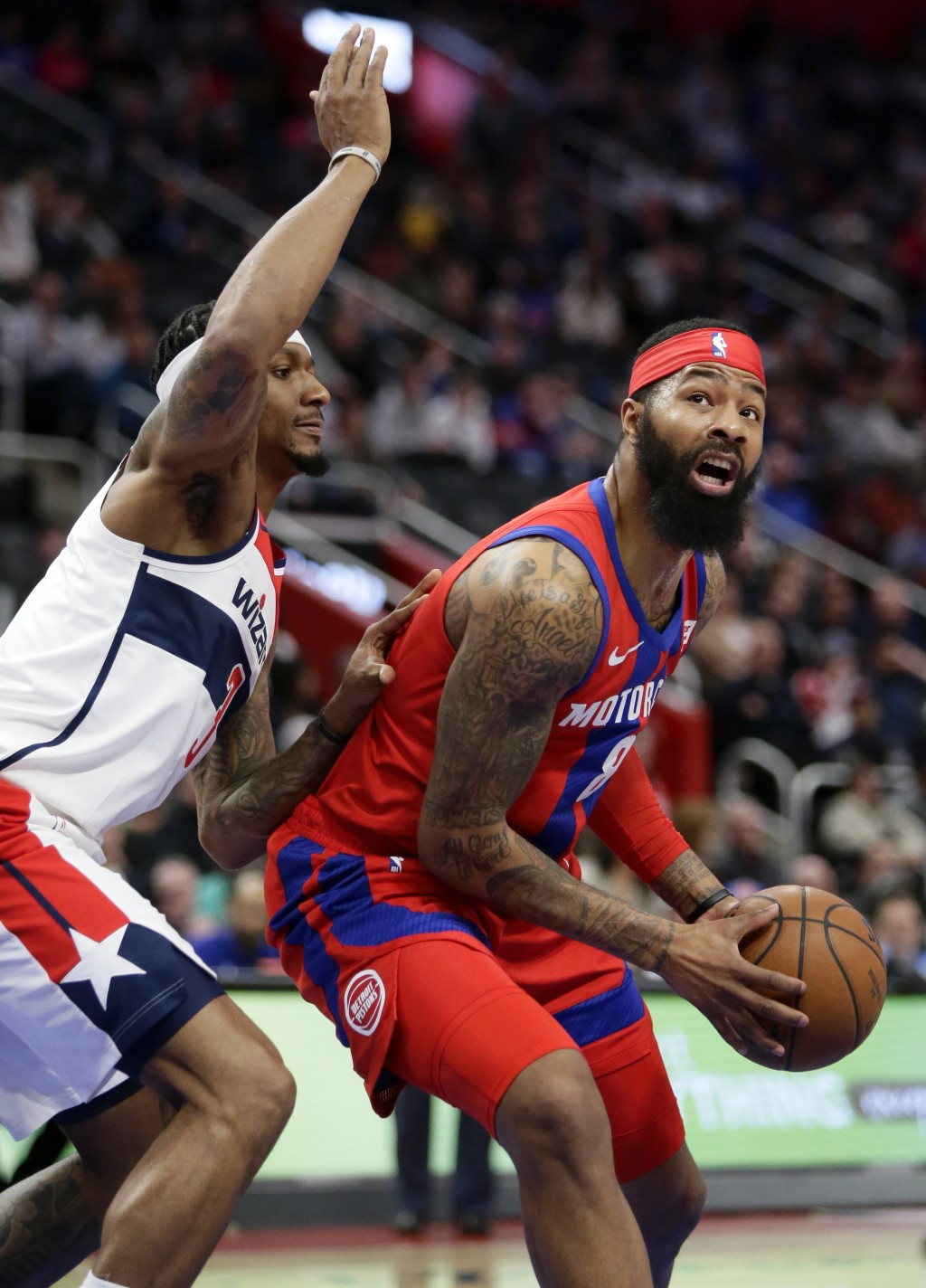 Detroit Pistons forward Markieff Morris (8) goes to the basket against Washington Wizards guard Bradley Beal (3) during the first half of an NBA baske...