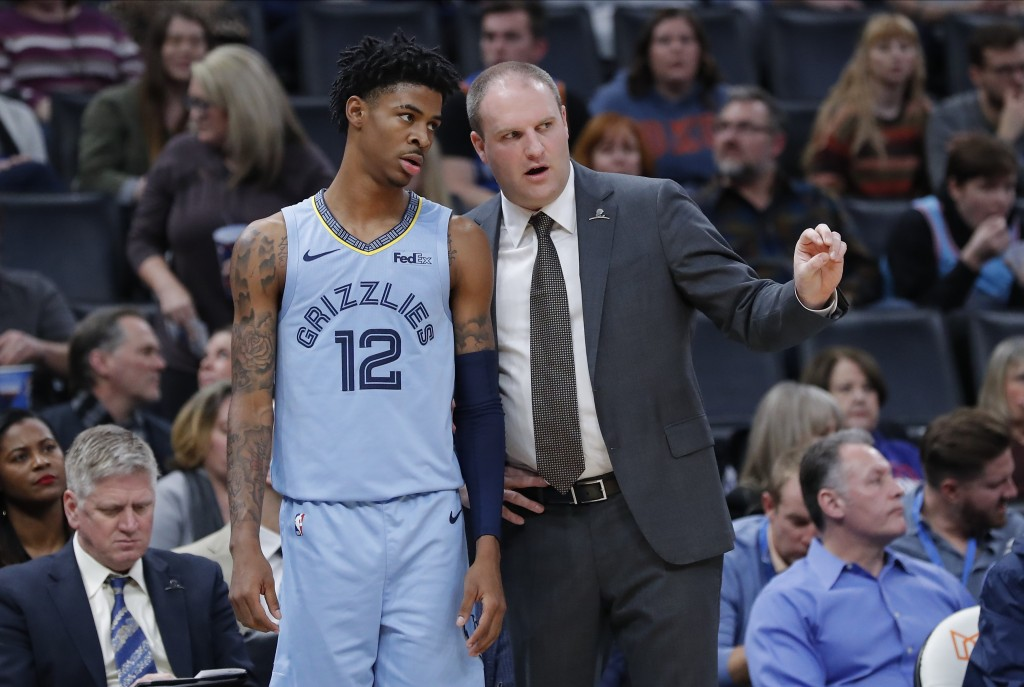 Memphis Grizzlies guard Ja Morant (12) listens to head coach Taylor Jenkins during the second half of an NBA basketball game against the Oklahoma Thun...