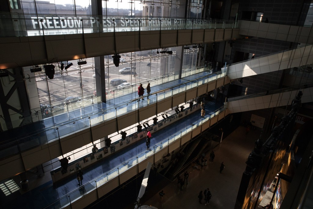 In this Friday, Dec. 20, 2019, photo, people visit the Newseum, in Washington. The Newseum will close the Pennsylvania Avenue location on Dec. 31, 201...