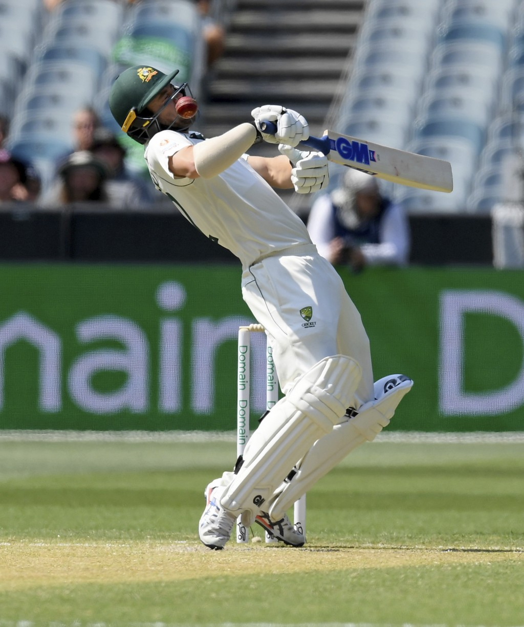 Australia's Travis Head avoids a bouncer from New Zealand's Trent Boult during play in their cricket test match in Melbourne, Australia, Friday, Dec. ...