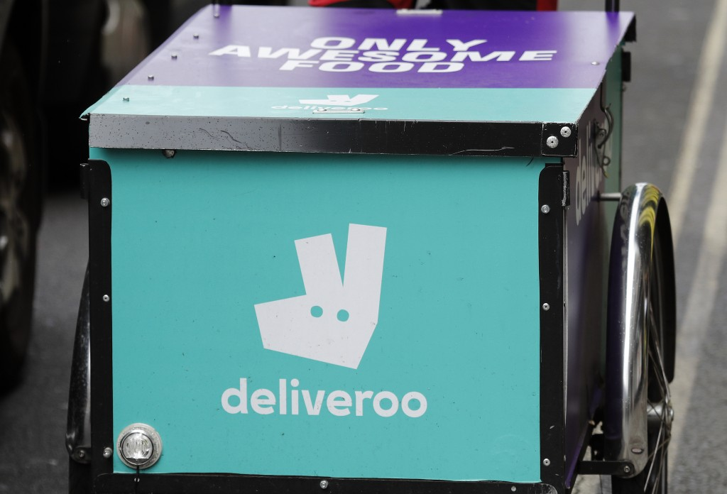 FILE - In this Tuesday July 11, 2017 file photo, a Deliveroo logo on a bicycle in London. British regulators said Friday Dec. 27, 2019, they are launc...