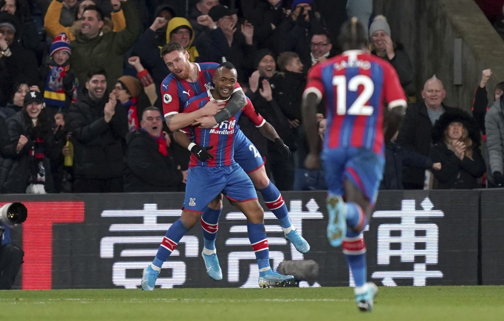 Crystal Palace's Jordan Ayew, bottom left, celebrates scoring his side's second goal of the game during their English Premier League soccer match agai...