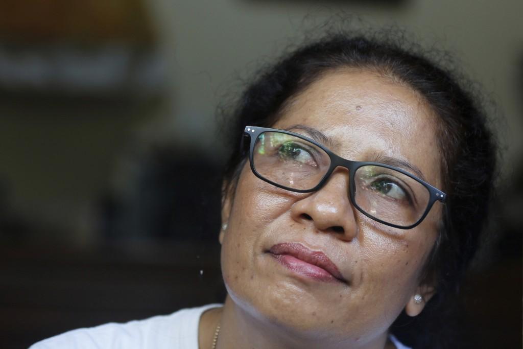 Ni Luh Erniati sits in her home in Bali, Indonesia on Friday, April 26, 2019. Erniati's husband, Gede Badrawan, was one of 202 people killed in the 20...